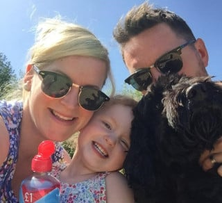 Dog Ernie with his family for Vets Now article on dangers of mince pies to dogs