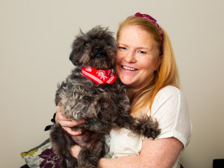 Image of dog owner with her pet who was injured in a RTA